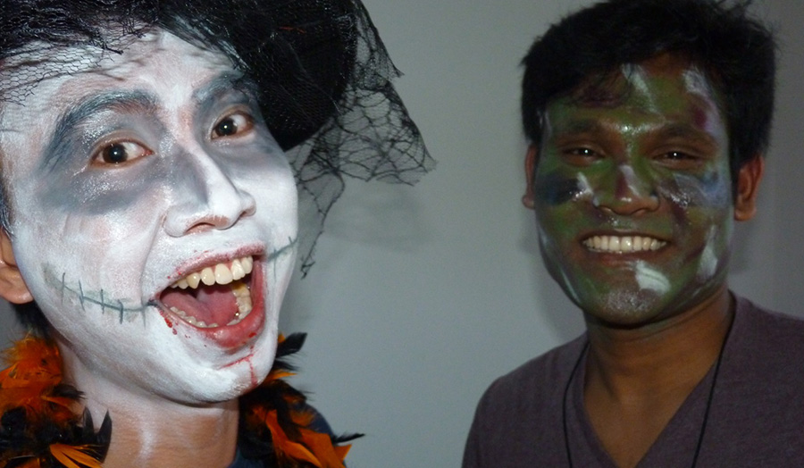 Students with painted faces at a Halloween Party