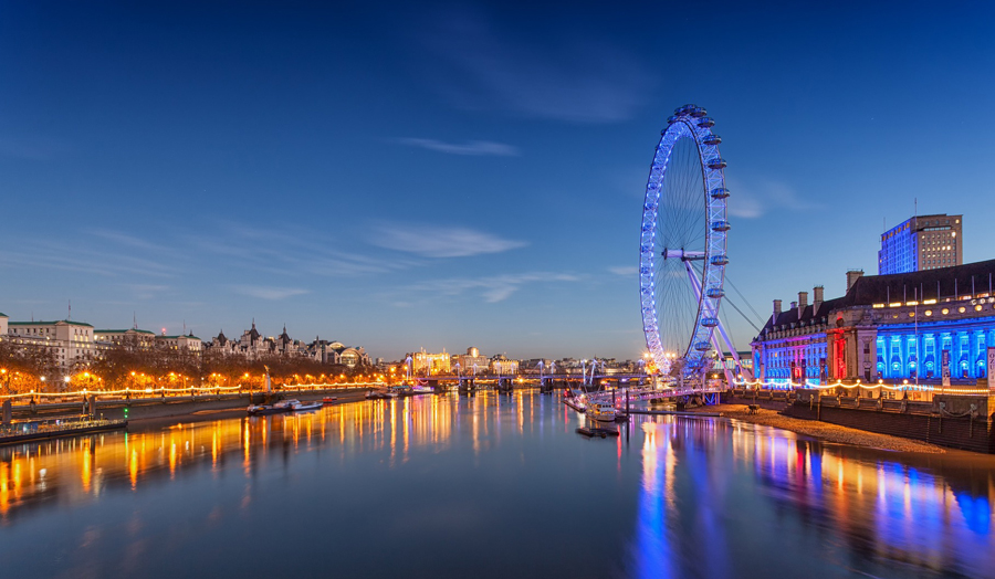 River Thames and London Eye lit up at night