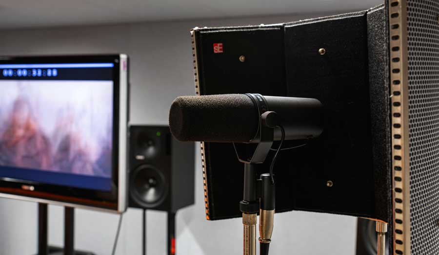 image of surround sound studio equipment: ADR in the forefront, a screen and speaker in the background