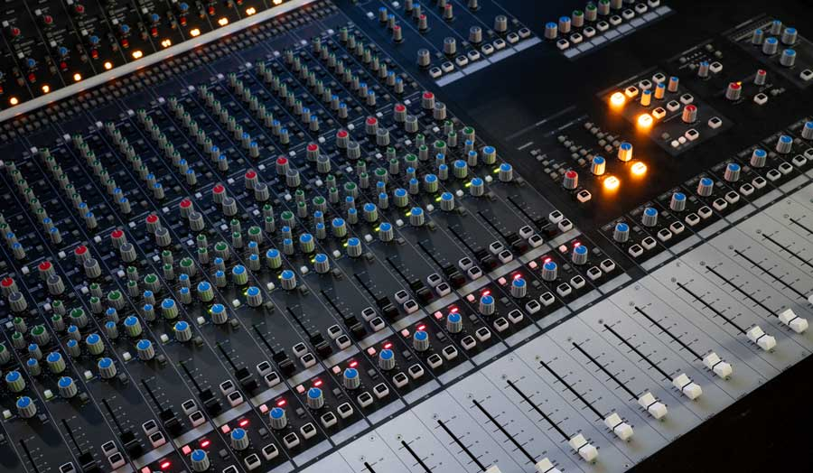 an image of an audient desk or mixing deck in a music control room