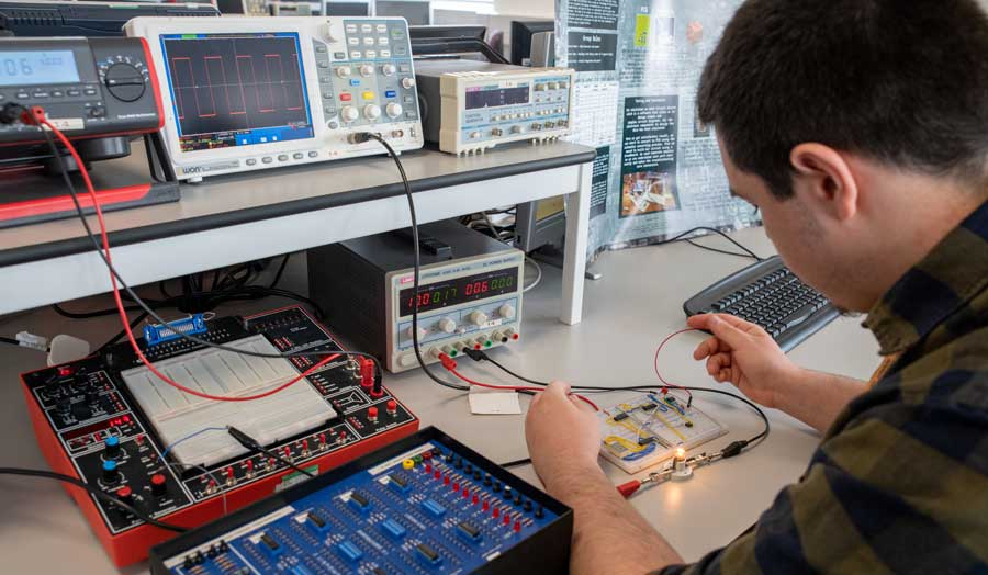 student testing his electronics circuit