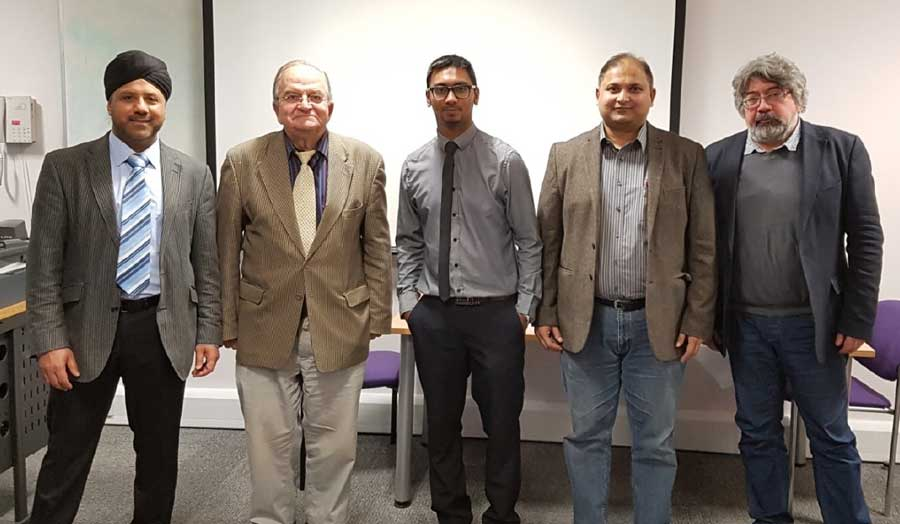 4 academics and PhD student Leckhun Kumar Mewhoor after he successfully defended his PhD