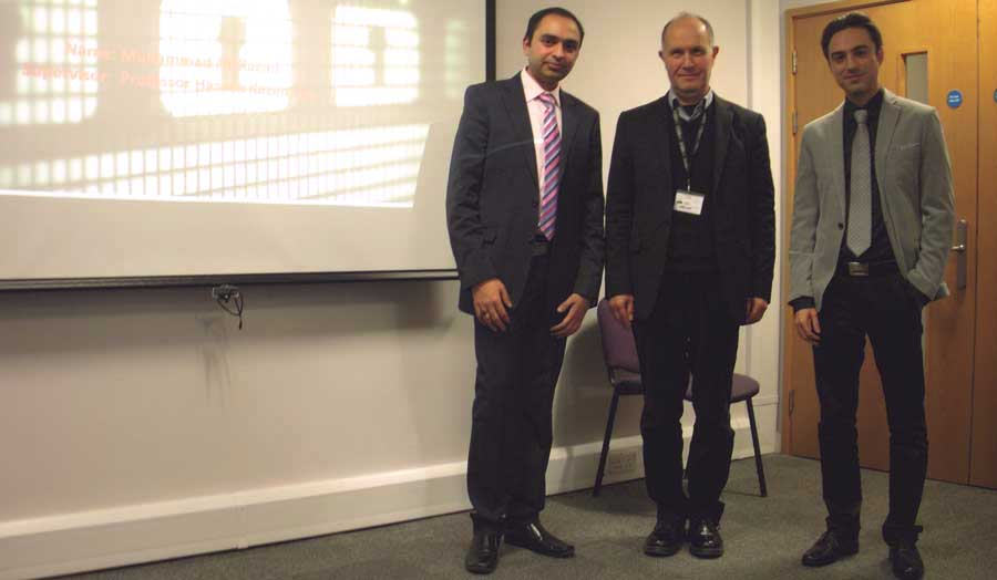 Prof Kazemian, Mohammadhossein Amirhosseini and Muhammad Ali Kazmi in front of a screen