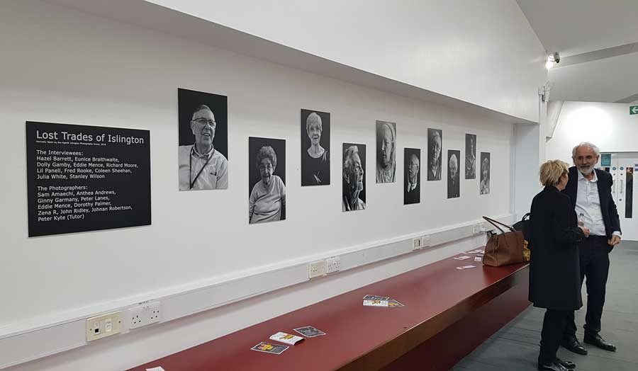 Photos of participants of Lost trades of Islington hanging of the wall for the launch event