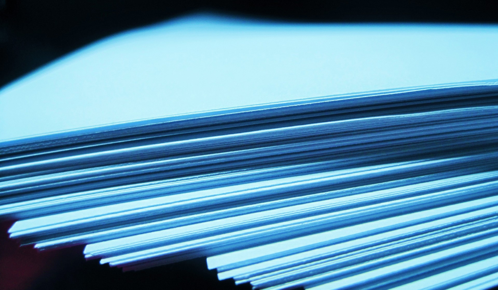 A stack of papers representing the dissertations submitted for the competition.