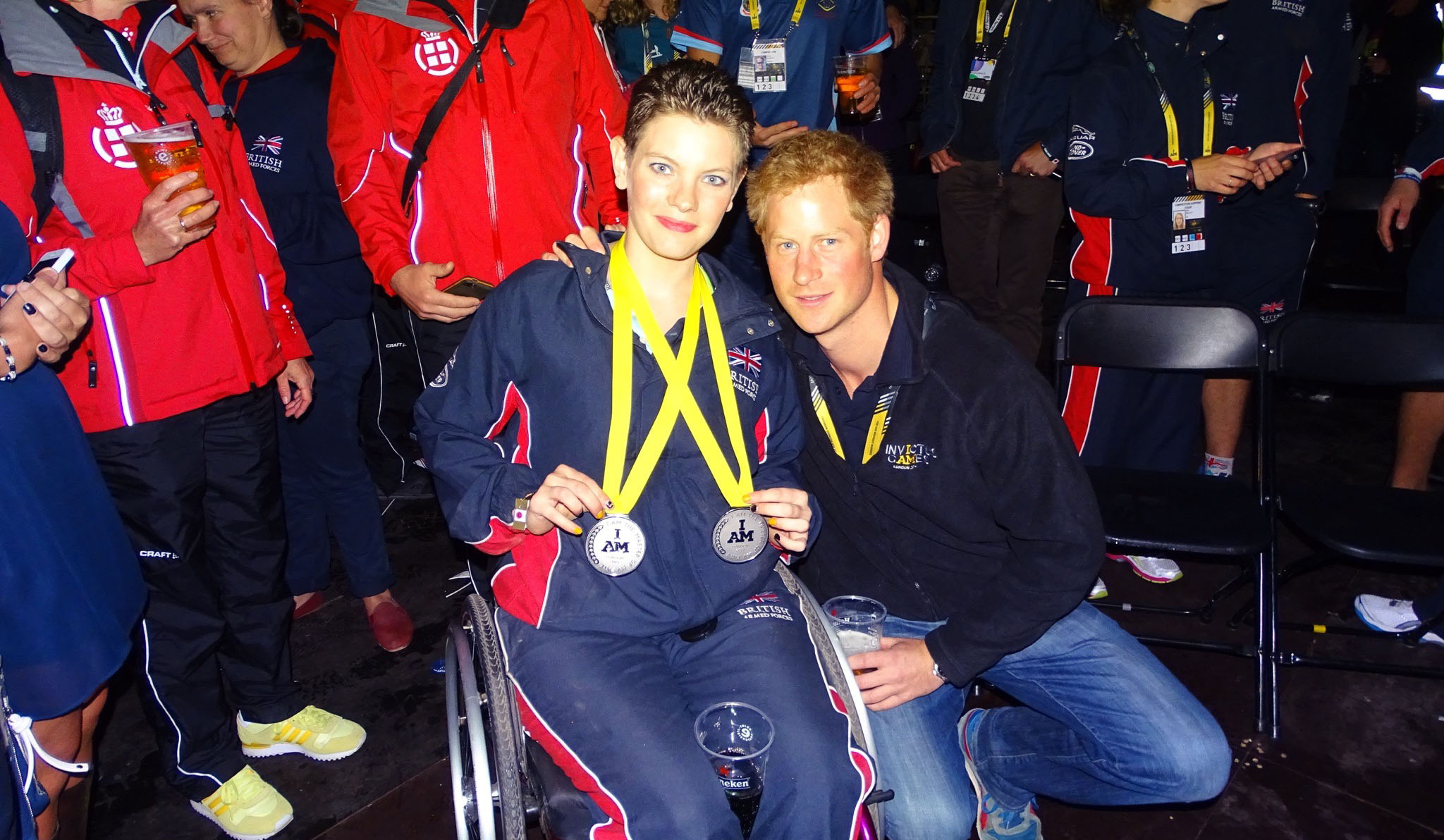 Student Susan Cook with Prince Harry and her silver medals at the Invictus Games.