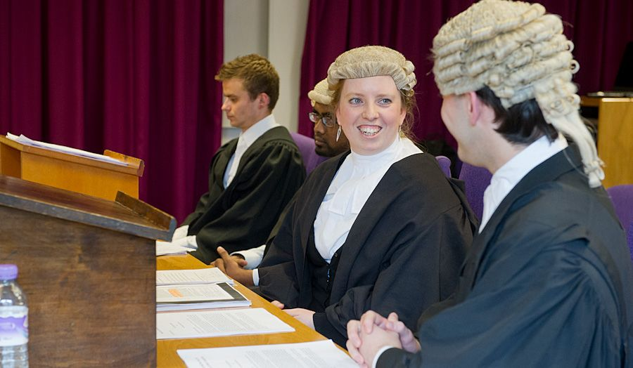Mooting competition photo of girl smiling in a wig