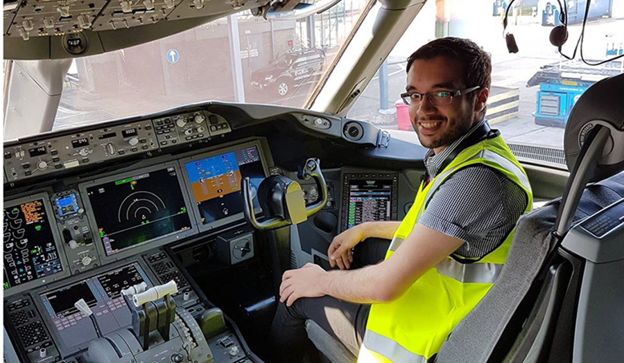 An image of Khalid Elkhazmi in the cockpit of an airplane.