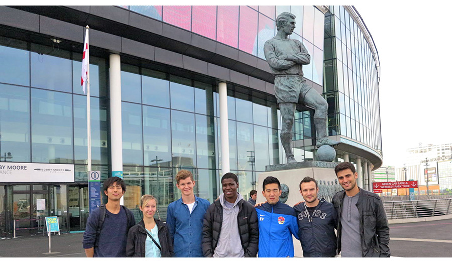 Sports Management Postgraduates by the Bobby Moore Statue at Wembley Stadium.
