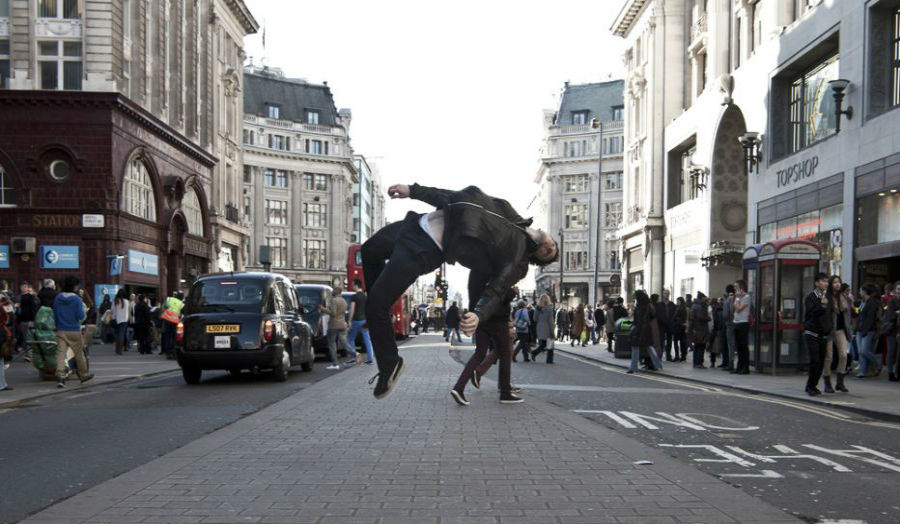 A photograph of a man back-flipping in Oxford Street