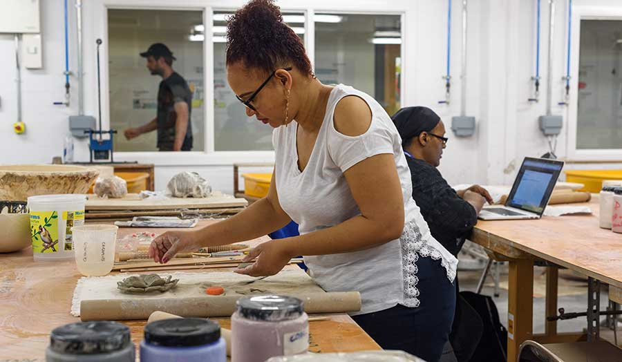 a student working in the ceramics studio