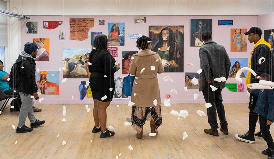 visitors viewing students' painting at The Cass summer show