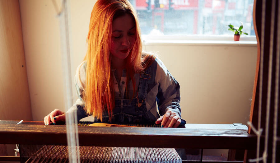 Photo of Claire Whelan at a loom