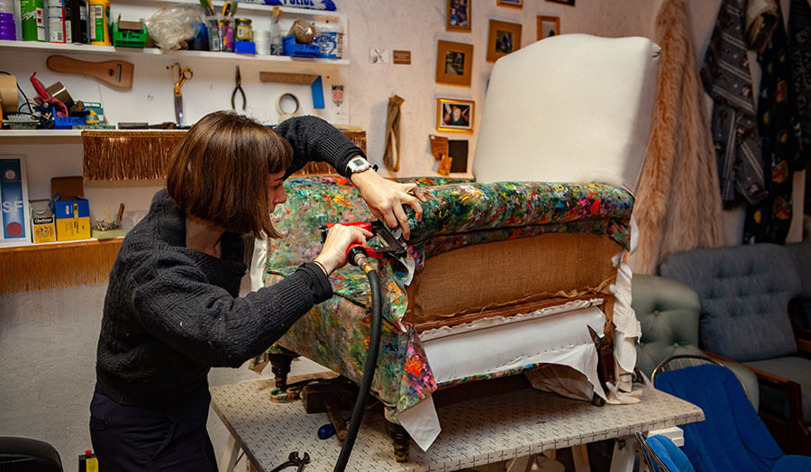An image of Vanessa Butt working on a chair