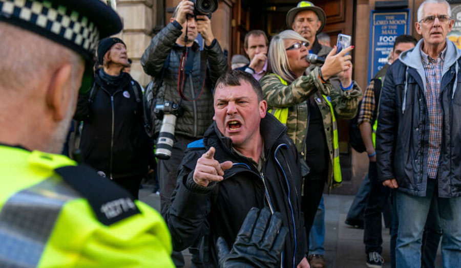 Urte Fultinaviciute, Brexit supporter arguing with a policeman during the People's Vote protest in London, 2019