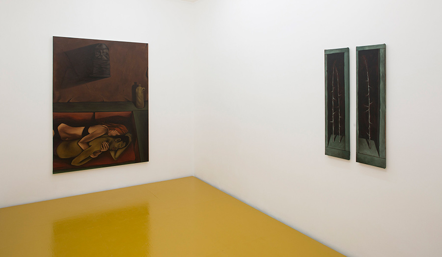 A gallery room with two paintings on white walls and a yellow painted floor