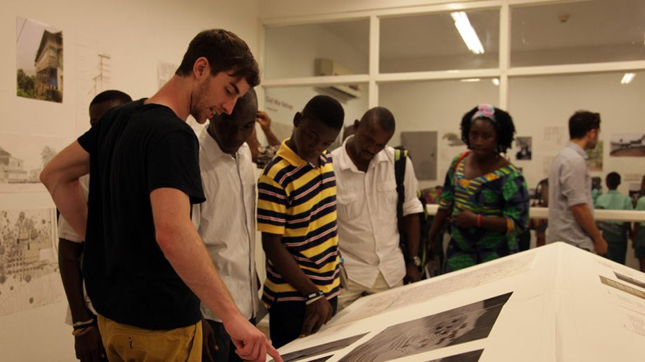 LMU students discuss drawings Freetown