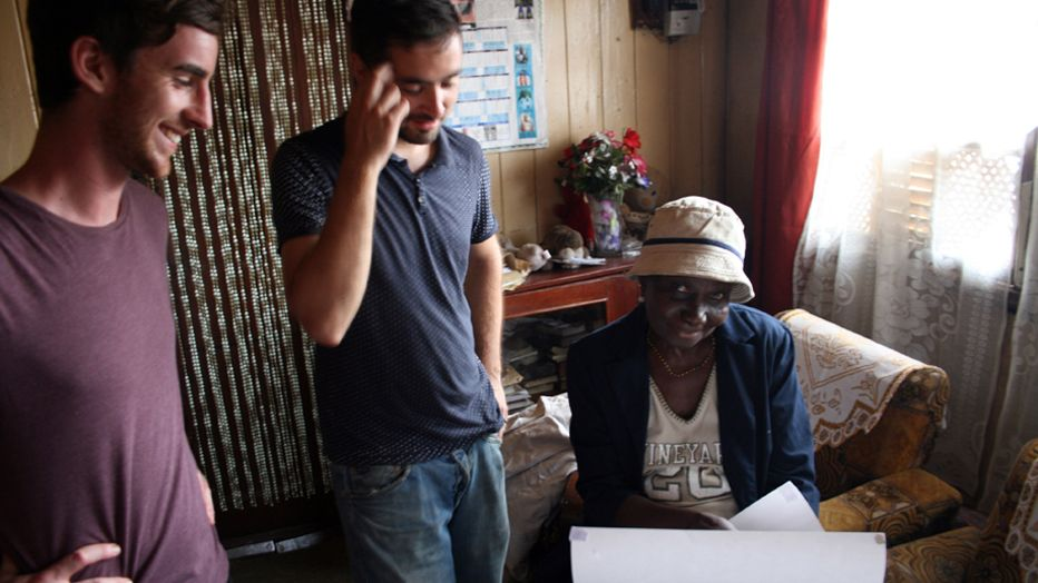 Presenting a resident with the surveys of the home Freetown