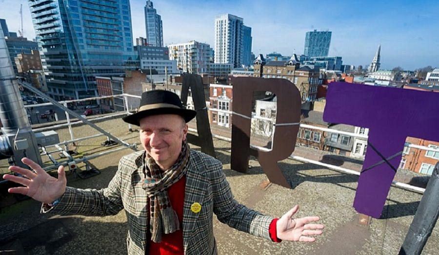Bob and Roberta Smith with test letters for the planned ART MAKES PEOPLE POWERFUL installation on Central House Roof