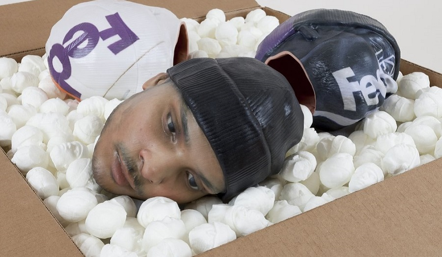 Kline Josh Packing for Peanuts Fedex Worker's Head with Knit Cap 2014 USA Photo by Joerg Lohse (DETAIL)