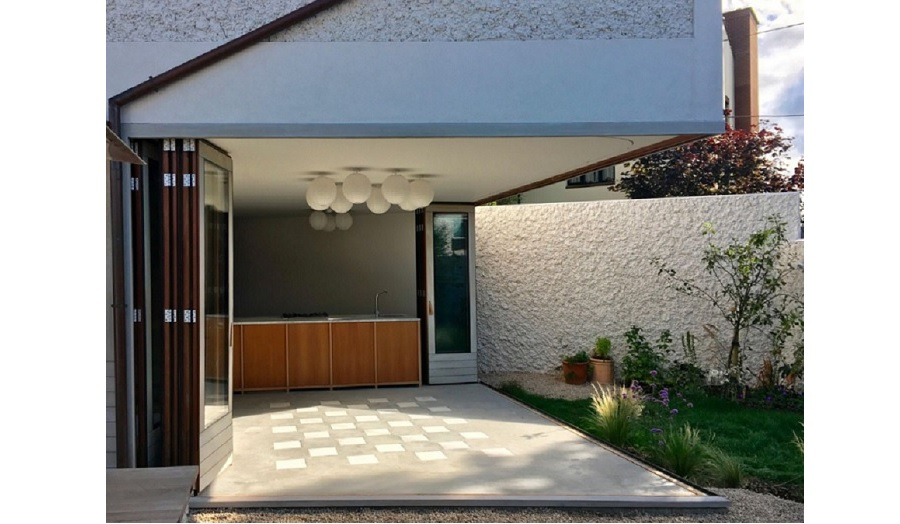 rera of a house with patio doors open fully so it becomes part of outdoor space