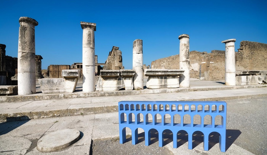 photograph of  blue furniture based on aquedact taken in roman ruins