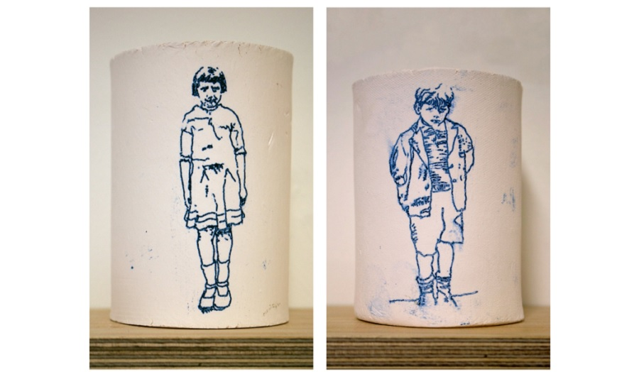 two ceramic containers illustrated with prints of children