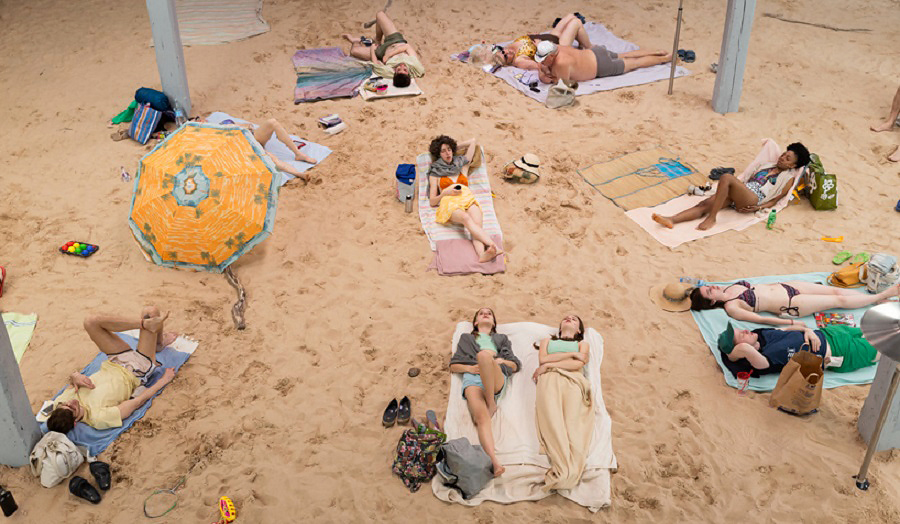 People sunbathing on a beach
