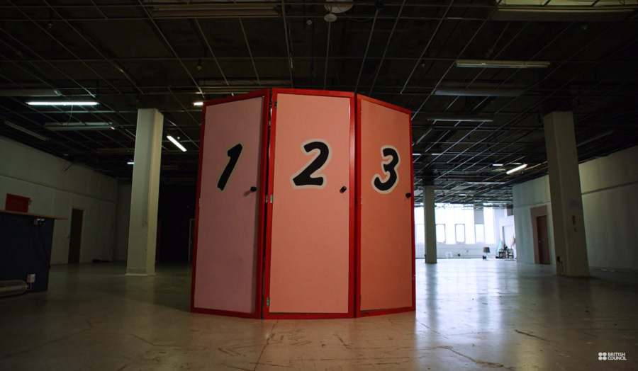 Three aligned doors with the numbers 1, 2 and 3 painted on them