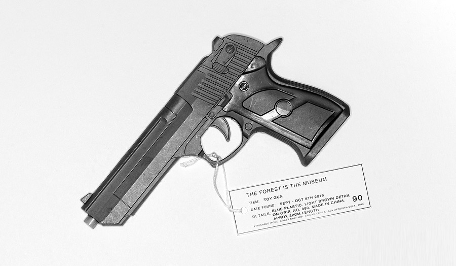 A gun with a label
