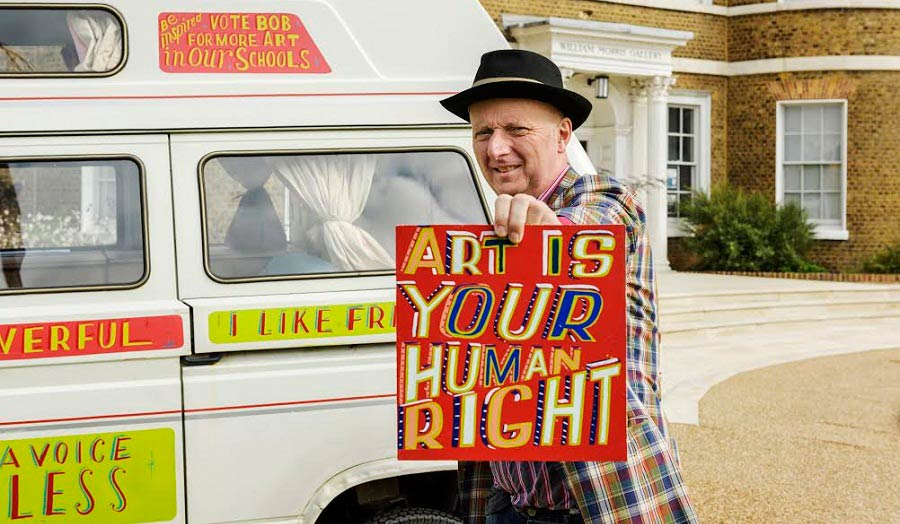 Artist Bob and Roberta Smith showing a placard
