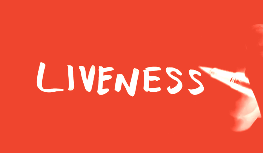 The word LIVENESS written on red background
