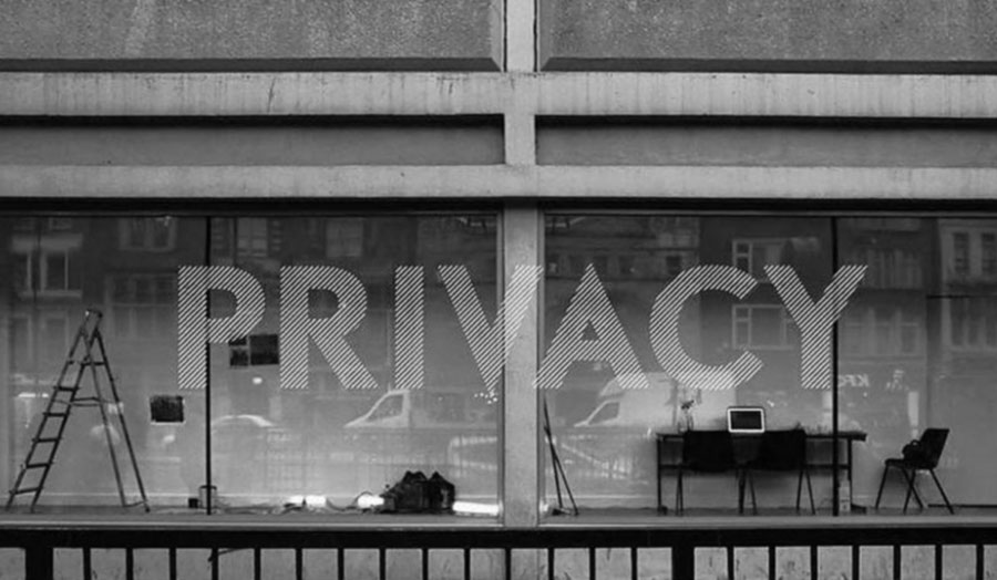 "Image of the window to the gallery. The word ""privacy"" is on the window."