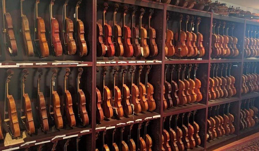 A shelf full of violins