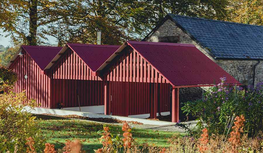 Row of red gabled sheds