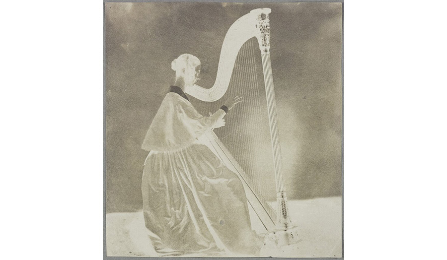 Horatia playing Amelina's harp (neg, reversed) from the Science Museum