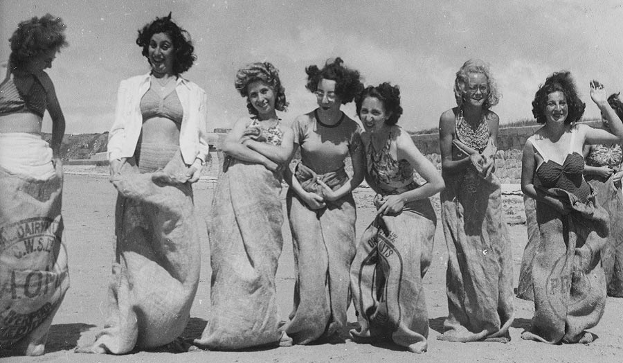 A group of women preparing for a sack race
