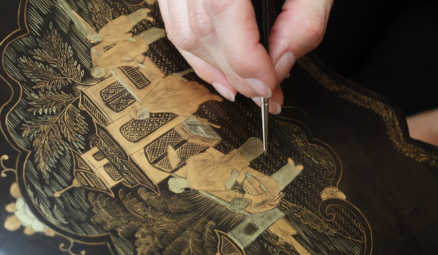 Detailed engraving and restoration on wood