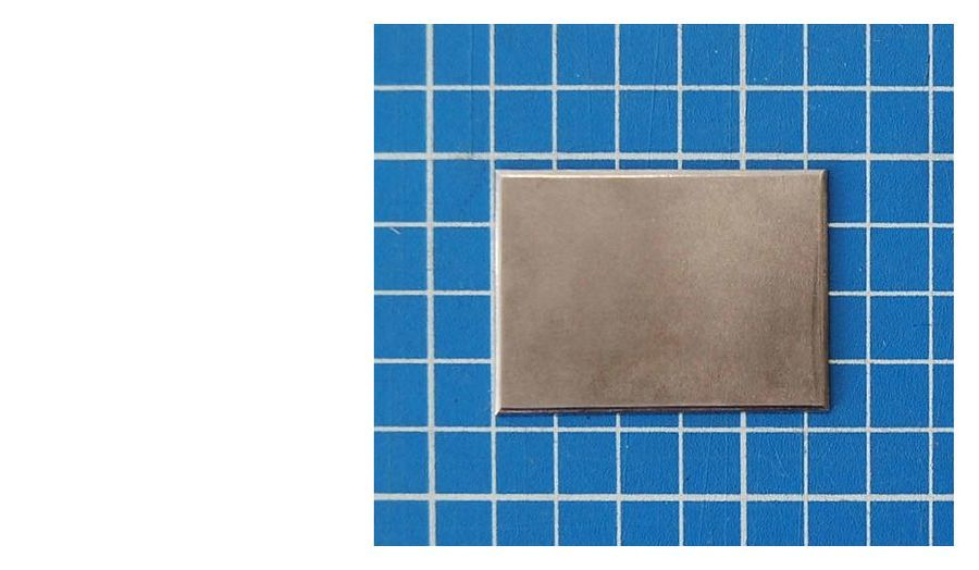 burnished_steel_plate_on_blue_cutting_mat