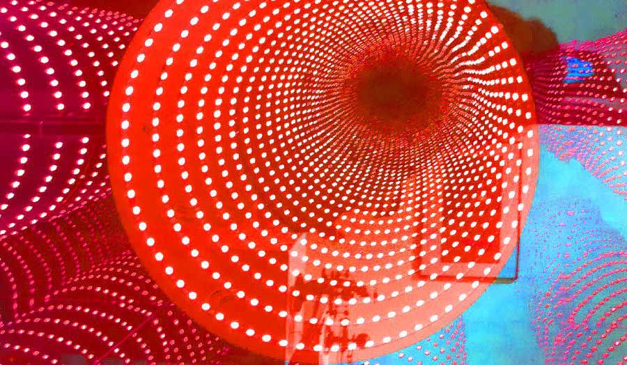 Reddish abstract image made of dotted concentric rings