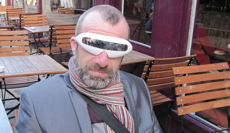 Man sitting on a terrace wearing a pair of glasses