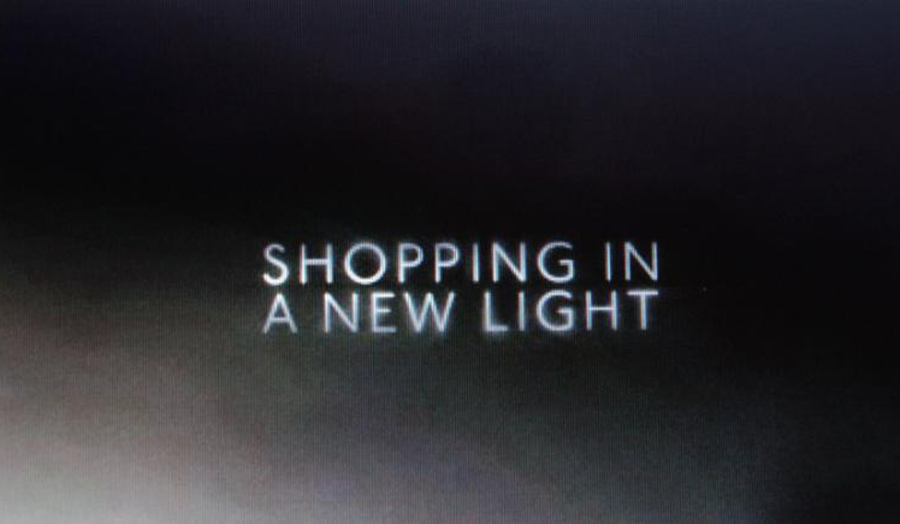 "The words, ""Shopping in a new light"" against a plain black background."