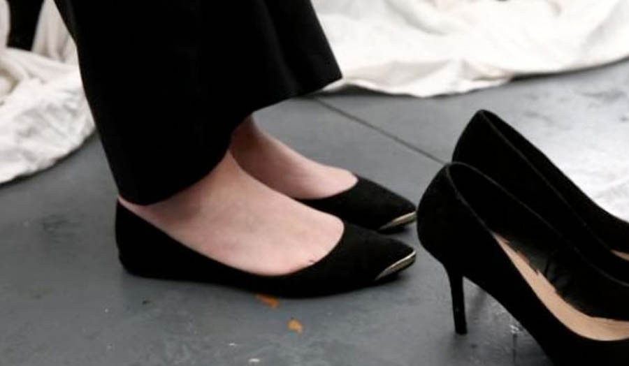 Photograph of Thorp's flat shoes next to a pair of high heels, 16 May 2016