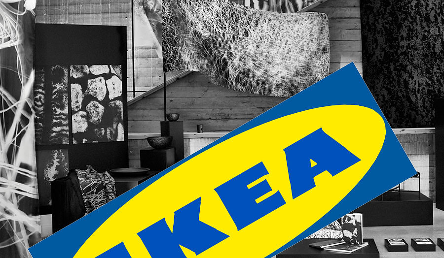 Black and white photograph of furniture with the blue and yellow IKEA logo on top of it.