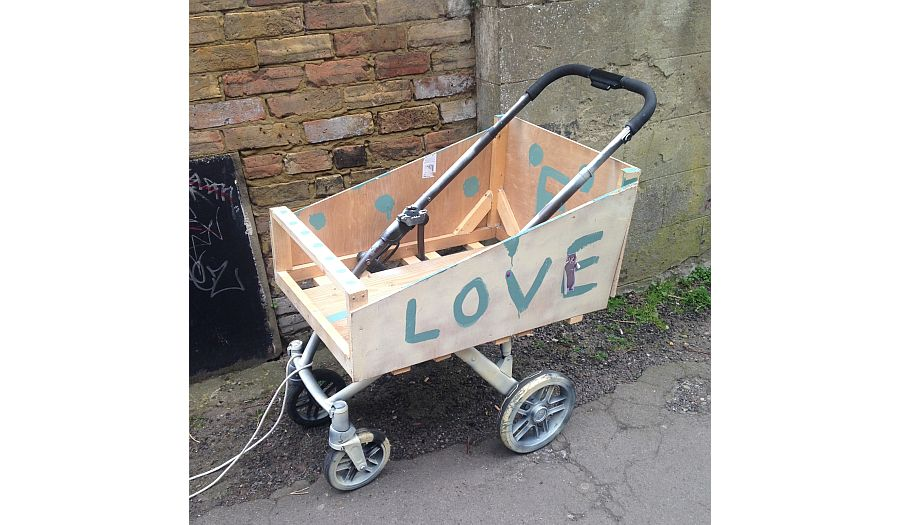 Photo image of a trolley with text 'I Love Painting Things'