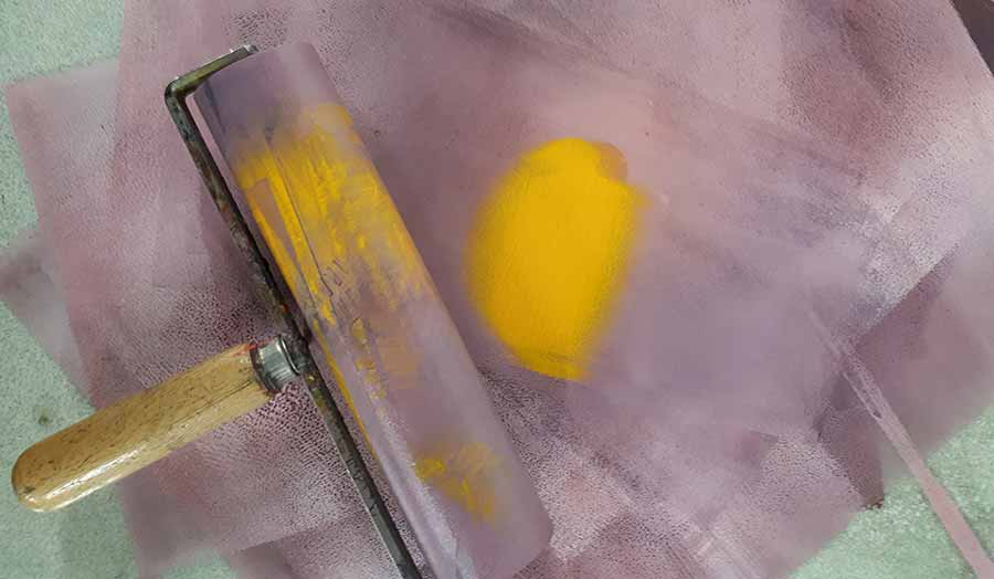 Roller and yellow paint