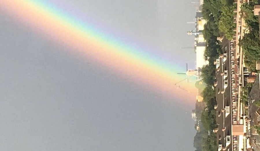 Sideways rainbow over town
