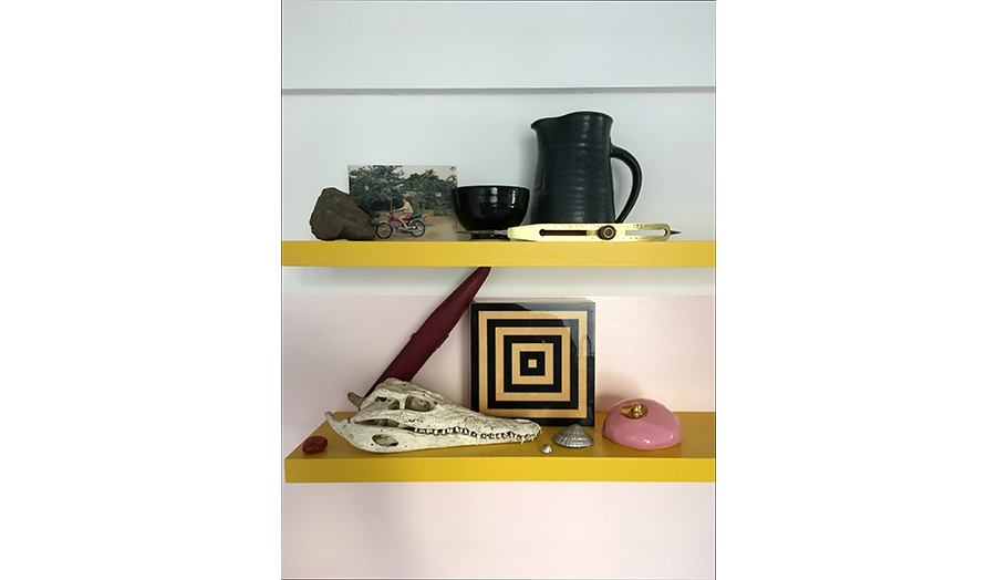 A diverse collection of objects on shelving to represent Studio 03