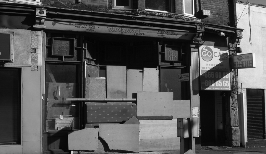Boarded up shops on Essex Road