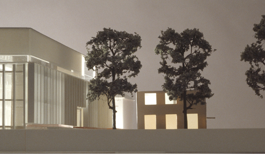white model of building with three trees